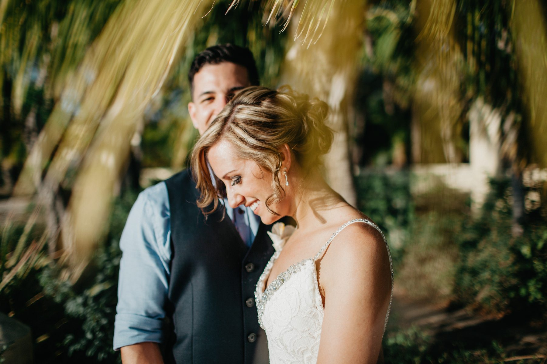 Bride and groom under a Palm in costa rica