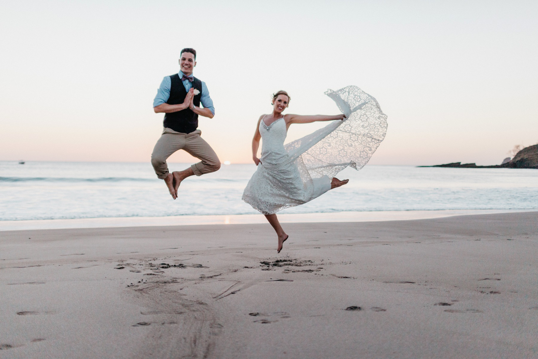 Wedding Beach jump of bride and groom