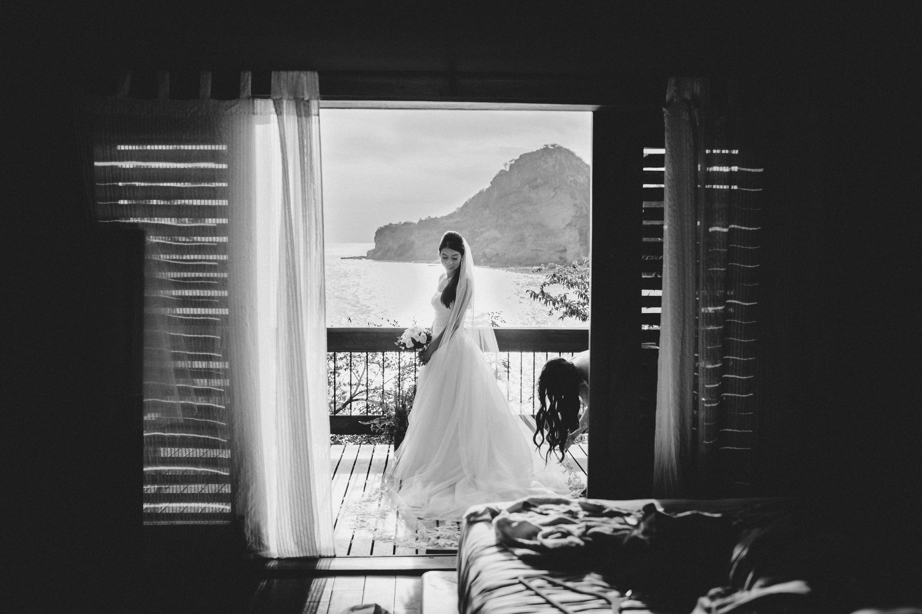 Beautiful bride in the window posing for photographer before her destination wedding in Nicaragua