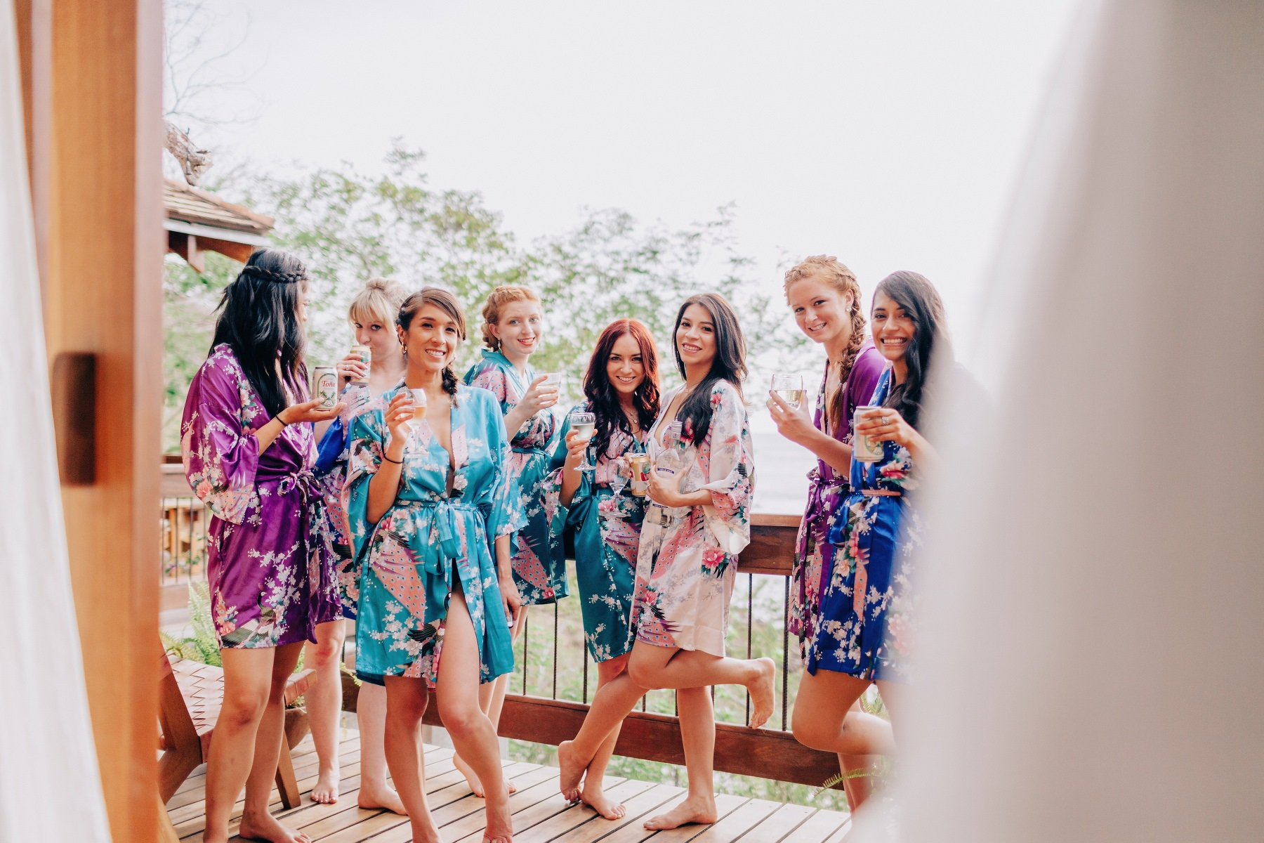 Bridesmaids and bride posing for photographer during a destination wedding in Aqua Nicaragua