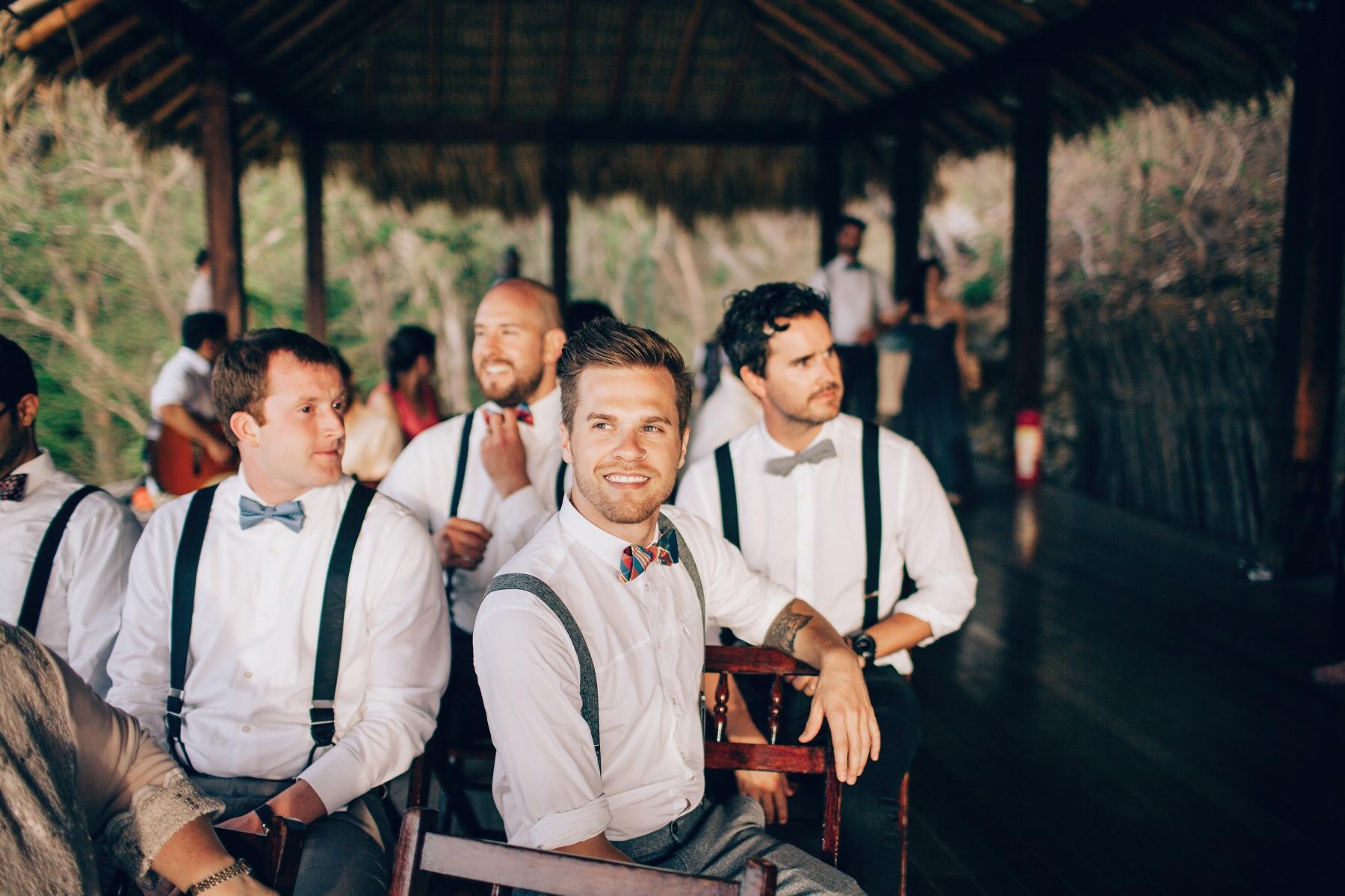 groomsmen during beach wedding