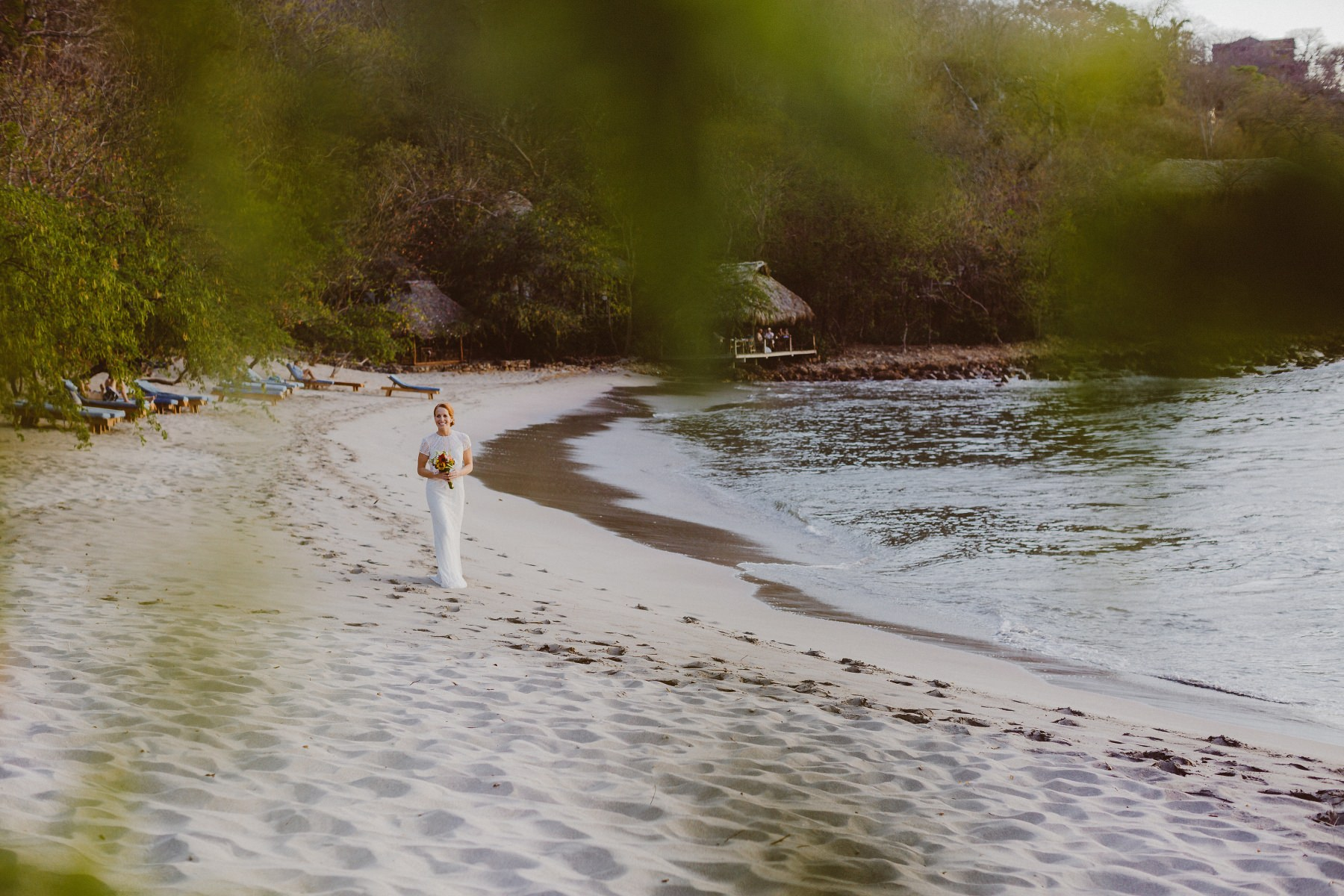 Bride walking over the beach during her elopement Wedding at the beach in Nicaragua