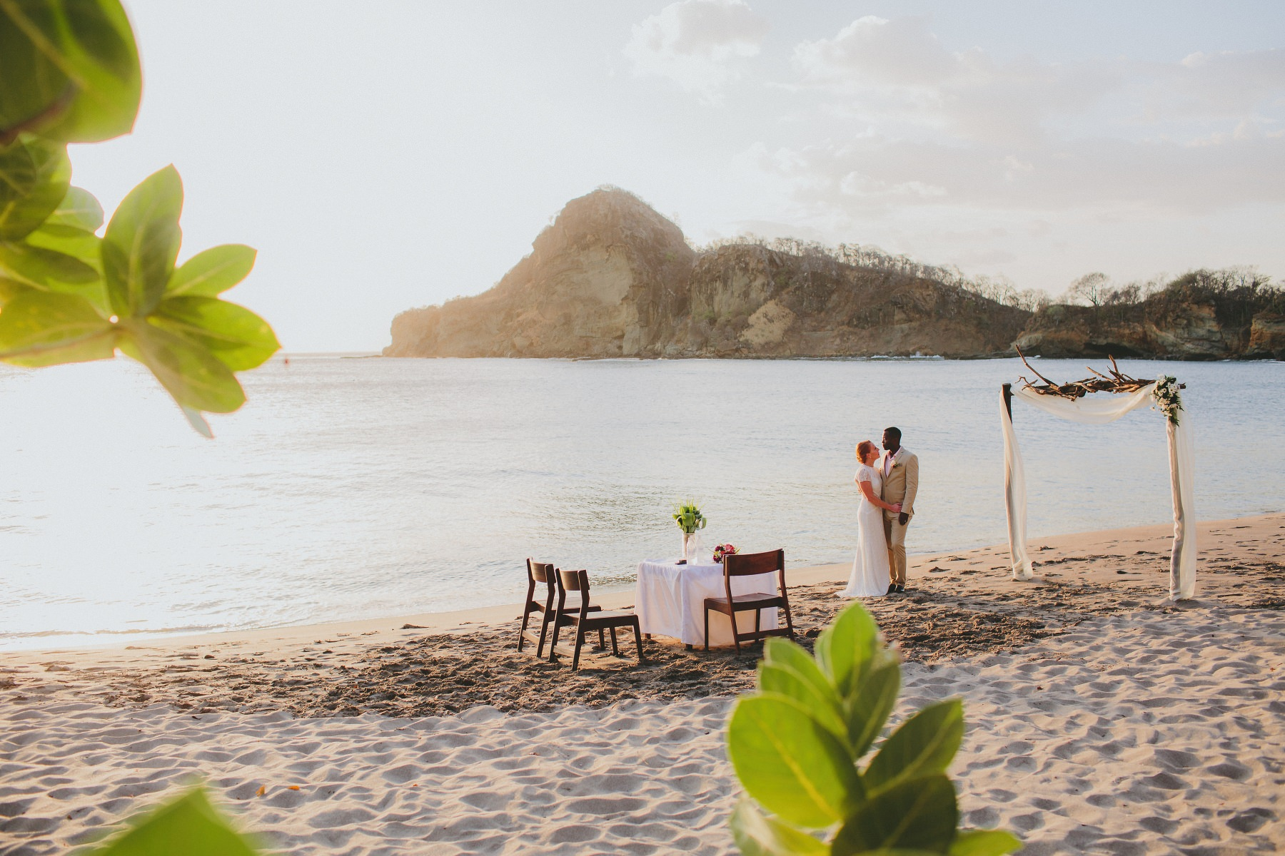 Elopement wedding photography at the beach in Nicaragua. Bride and groom embracing.