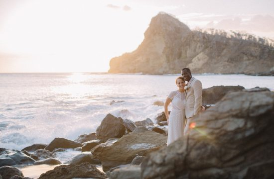 Elopement Wedding portrait photography in Nicaragua. Bride and groom posing for the photo. Beautiful beach and rocks in the background. Aqua Nicaragua. Rodonda bay