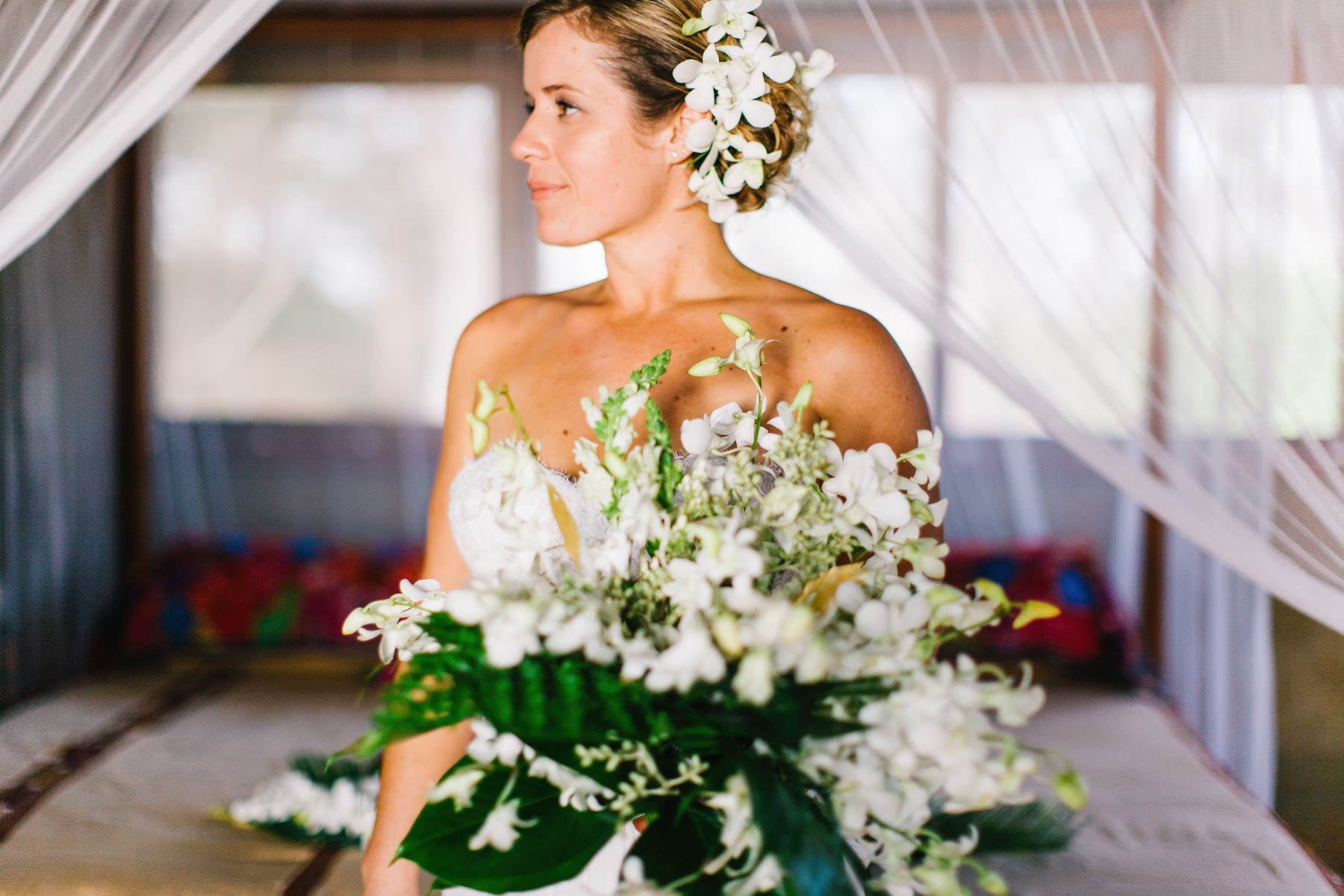 Bride with floral bouquet ideas. Boho destination wedding Sama-sex