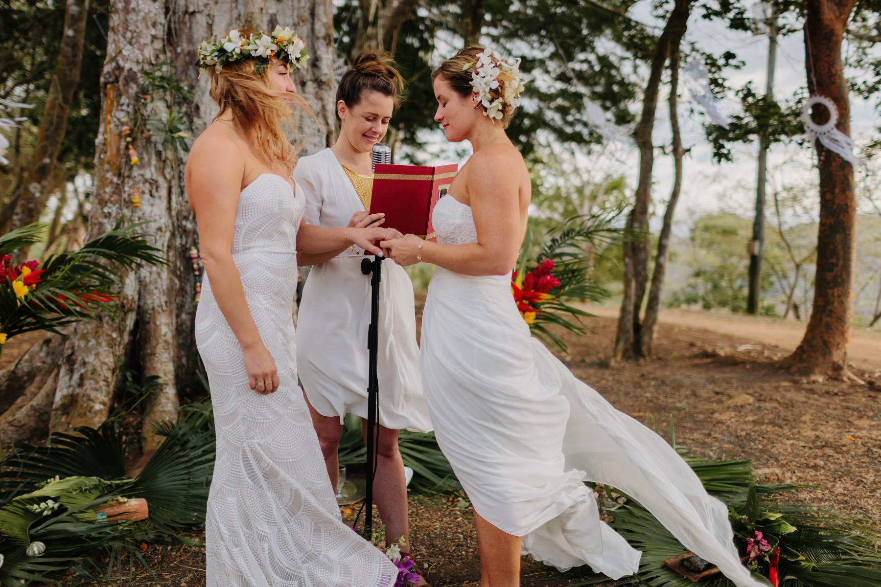 Boho Same-sex wedding under a tree in Costa Rica. Beautiful brides - wedding dress ideas