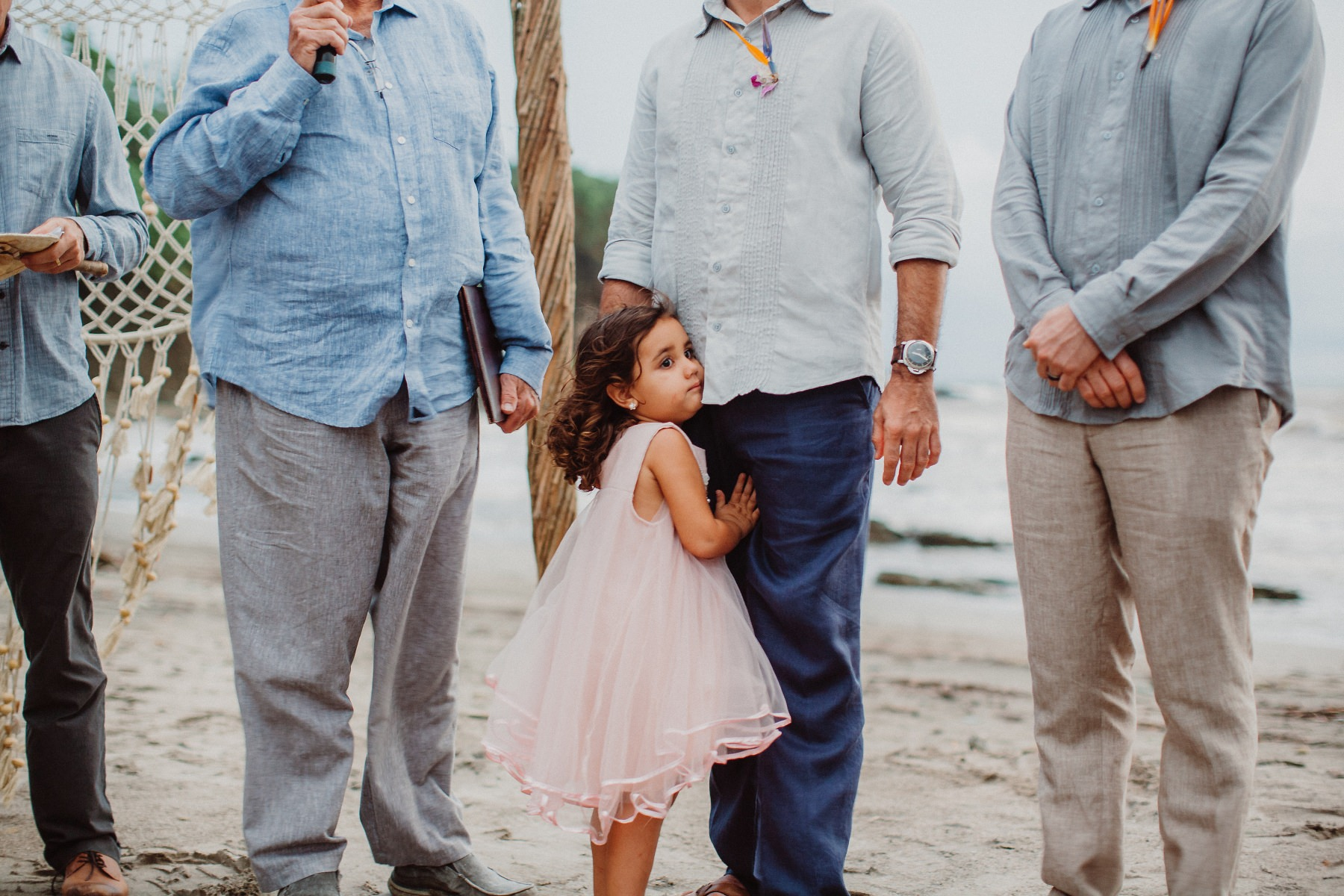 Daughter embracing her father during destination wedding in Costa Rica